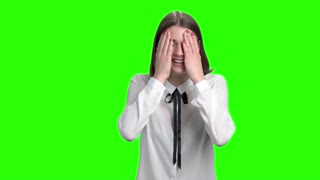 Portrait of young cute girl laughing hard, having fun. Cheerful woman, front view. Green screen hromakey background for keying.