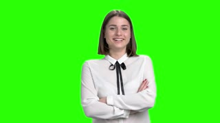 Portrtrait of cute girl laughing with teeth. Smiling young woman. Green screen hromakey background for keying.