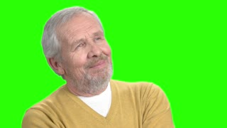 Positive thinking man, green screen. Cheerful senior man lost in thinking, chroma key background. Power of positive thinking.