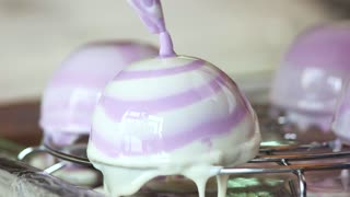 Preparing of mousse cake close up. The process of cooking french dessert. Yummy dessert of french cuisine. Culinary as art.