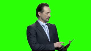 Presentable business speaker poritrait. Mature middle-aged handsome man in suit. Green hromakey background for keying.