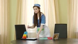 Pretty maid working. Caucasian girl flirting. Work and romance.