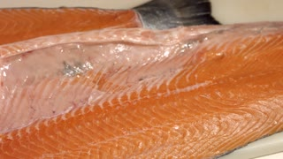 Raw fish with red meat. Fish on white wooden background. It's all muscle tissue. Best salmon for sushi rolls.