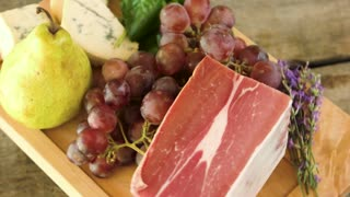 Raw food on wooden board. Frozen meat and cheese. Protein and vitamins.