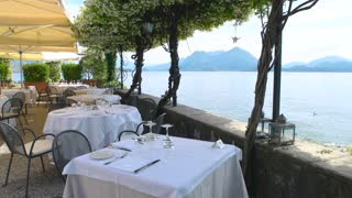 Restaurant terrace lake Maggiore. Scenic view from cafe, Italy.