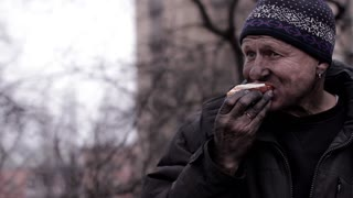 Revolutionary eating a sandwich. Worker eats earned for a day.