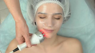 Rf face lift, collagen mask. Young woman undergoing skin treatment. Improving look without surgery.