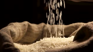 Rice falling in slow-mo. Sack with groats.