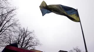 Riddled Ukrainian flag on the front lines. War in Ukraine. Checkpoint. The front line.