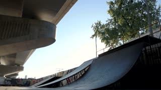 Rollerblader and ramp. Inline skater, urban background.