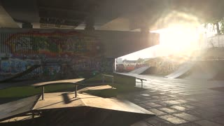 Rollerbladers in skatepark. Young people outdoors, daytime.