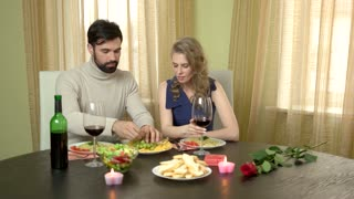 Romantic couple eating and laughing. Young man and woman indoor. Love is delicious.