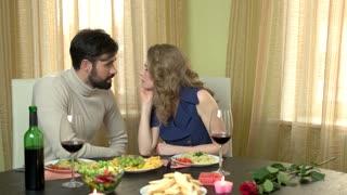 Romantic couple eating spaghetti. Beautiful woman and man.