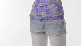 Rotating mannequin in short shorts. Light denim shorts for women. Clothing of high-quality fabric. Imported clothes on sale.