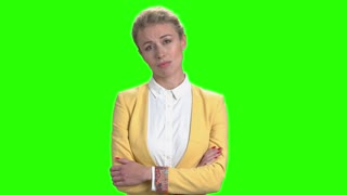 Sad business woman with arms crossed. Young bored business lady standing with folded arms on Alpha Channel background.