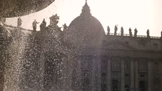 Saint Peter Basilica and sky. Fountain and religious building, sunlight.
