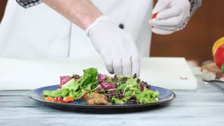Salad preparation, lettuce and pepper. Tasty food on a plate.