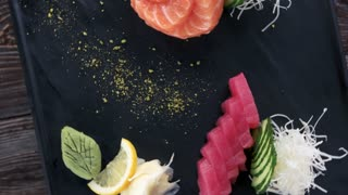 Salmon and tuna sashimi. Fish, ginger and wasabi.