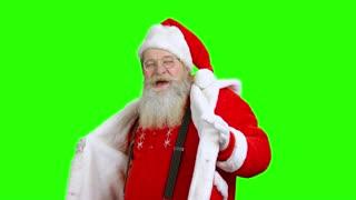 Santa Claus dancing, chromakey. Cheerful Santa on green background.