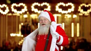 Santa Claus dancing. Santa on Christmas fair background. How to enjoy holiday season.