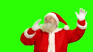 Santa Claus gesturing, green screen. Santa with raised hands.