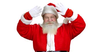 Santa Claus is welcoming you and wanting you to come. White isolated background.