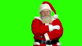 Santa Claus on green background. Santa with folded arms.