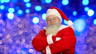 Santa Claus showing thumbs up. Santa, bright lights background.