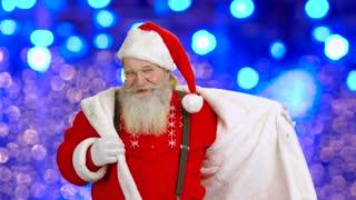 Santa dancing on lights background. Happy Santa Claus.