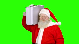 Santa holding briefcase, green screen. Santa Claus on chromakey background.