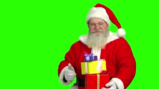 Santa holding gifts, green screen. Thumb up, Santa Claus.