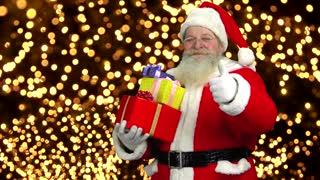 Santa holding gifts, thumb up. Santa Claus, Christmas lights background.