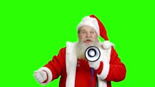 Santa with a loudspeaker, chromakey. Santa Claus on green background.