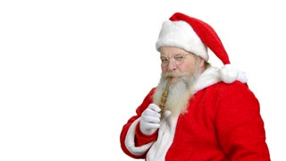 Santa's passionate to smoking the pipe. Smoking santa in the white isolated background.