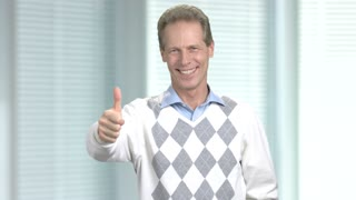 Satisfied mature man with thumb up. Happy caucasian man showing gesture ok. Cheerful european middle-aged guy.