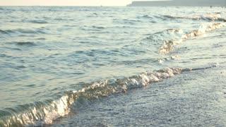 Sea waves with foam close up. Sea shore beach.