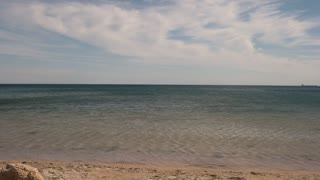 Seashore and sky. Water and sand. Good place for summer vacation. Warm climate of tropics. Wind on the beach.