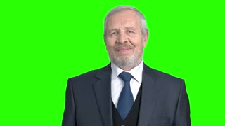 Senior businessman crossed arms on green screen. Elderly man in formal wear with crossed arms on alpha channel background. Handsome old businessman.