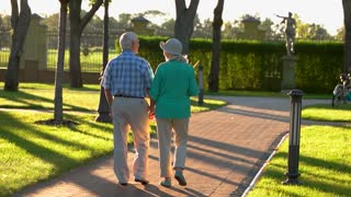 Senior couple walking in slo-mo. Elderly people hold hands. Respect past and cherish present. We are grateful to fate.