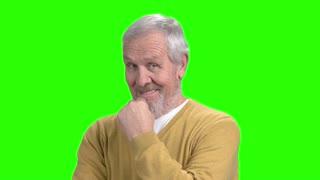Senior flirting man, green screen. Elderly macho man on chroma key background. Flirt and temptation concept.