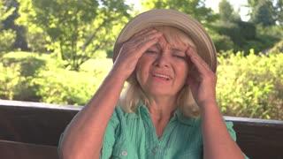Senior lady has headache. Woman taking medicine. Drug that stops pain. Main symptom of hypertension.