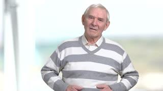 Senior man having stomach pain. Elderly man with stomachache on blurred background. Abdominals problem concept.