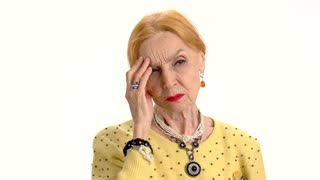 Senior woman has headache, isolated. Upset lady touching her head. High intracranial pressure.