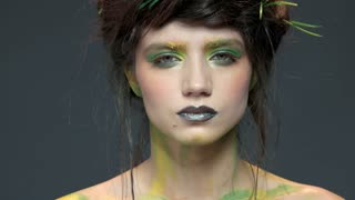 Serious face of young woman. Young makeup model.