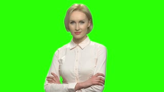 Sexy blond business woman portrait. Green screen hromakey background for keying.