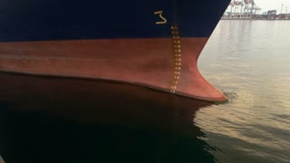 Ship nose on port background. Anchor and ropes. Maritime economy development.
