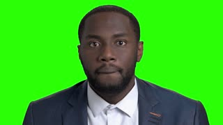 Shocked afro american businessman on green screen. Face of amazed afro american guy in formal wear on Alpha Channel background.