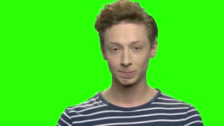 Shocked happy caucasian teen boy. Handsome surprised child. Green screen hromakey background for keying.