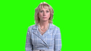 Shocked mature woman on chroma key background. Middle-aged woman looking scared on Alpha Channel background. Human expressions of shock.
