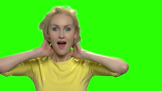 Silly middle aged woman making funny faces. Green hromakey background for keying.